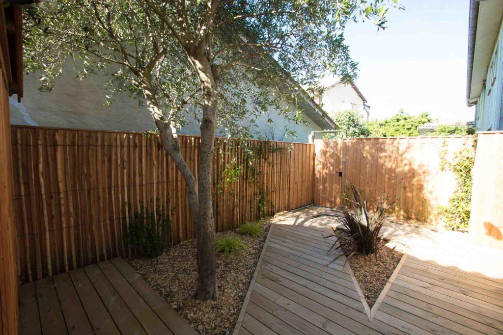 clôture en bois avec terrasse caillebotis au Cap Ferret